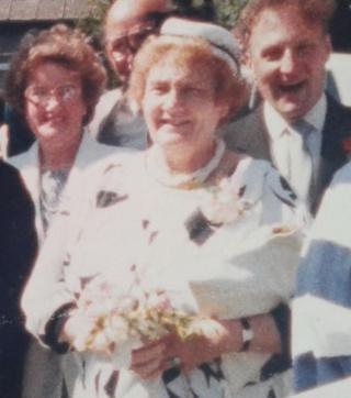 Gladys (Mum, Dad and Lancel) at a wedding